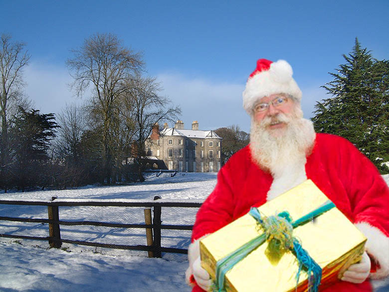 Santa outside snow-covered Doneraile Court