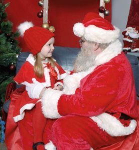 Santa chats with little girl visiting him