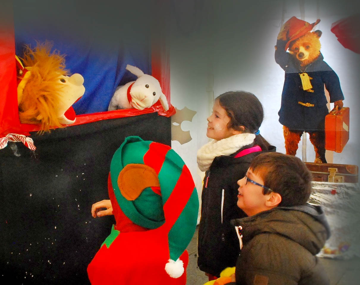Children enraptured by puppets in the Puppet Show at Santa's Wonderland At Doneraile